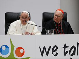 Pope Francis speaks at a pre-synod gathering of youth delegates in Rome. Also pictured is Cardinal Kevin Farrell, head of the Vatican's Dicastery for Laity, the Family and Life.