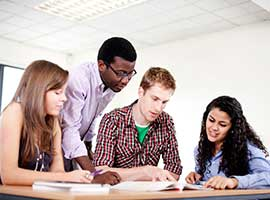 Four high school students studying together. iStock photo.