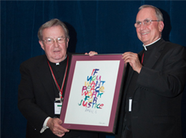 Bishop Blaire presents Bishop Morin with the CCHD Sister Margaret Cafferty Development of People Award in recognition of his dedicated service to the poor.