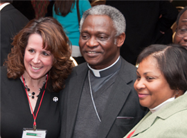 Cardinal Turkson stops to meet CSMG participants after his plenary presentation.