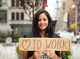 woman with work sign labor day statment 2014