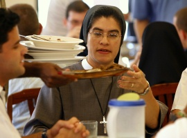 Sister M. Seraphica Montez, a U.S. nun with the Sisters of St. Francis of the Martyr St. George, eats lunch with Cuban seminarians at San Carlos and San Ambrosio Seminary outside Havana. CNS photo/Nancy Phelan Wiechec