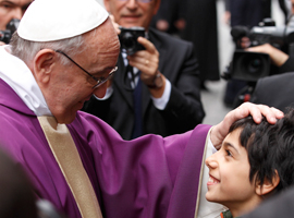 Pope-Francis-greets-boy-after-celebrating-Mass-at-St.-Anne's-Parish-within-Vatican-cns-paul-haring.jpg