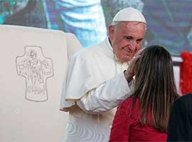 Pope Francis greets a young woman as he leads a meeting with young people along the waterfront in Asuncion, Paraguay, July 12, 2015. CNS photo/Paul Haring