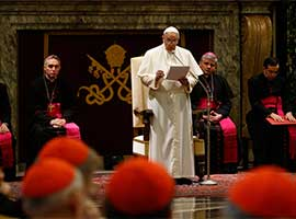 Pope Francis gives a speech during an audience to exchange Christmas greetings with members of the Roman Curia in 2014. CNS Photo/Paul Haring