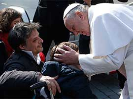 Pope Francis greets a disabled person during a March 2015 general audience. CNS Photo/Paul Haring