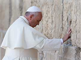 Pope Francis prays at the Western Wall in Jerusalem in May 2014. CNS photo/Paul Haring