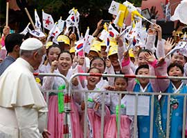 Young people in traditional dress cheer as Pope Francis arrives for a meeting with representatives of religious communities working in South Korea during an encounter in Kkottongnae, South Korea, in August 2014. CNS photo/Paul Haring