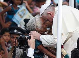 Pope Francis greets an elderly woman as he arrives to pray at the Sanctuary of Our Lady of the Rosary in Madhu, Sri Lanka, in January, 2014. CNS photo/Paul Haring