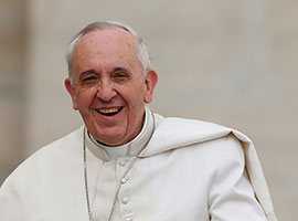 Pope Francis smiles as he arrives to lead his general audience in St. Peter's Square at the Vatican Feb. 19, 2014. CNS photo/Paul Haring