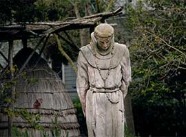 A stone statue of Blessed Junipero Serra by artist Arthur Putnam is seen in the cemetery and garden at Old Mission Dolores, in San Francisco. CNS photo/Nancy Wiechec