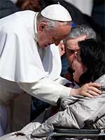 Pope Francis greets a disabled woman overcome with emotion during a March 2015 general audience. CNS Photo/Paul Haring
