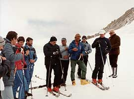 Pope John Paul II (center, in red boots) prays with a group of skiers before heading down a slope in this 1984. CNS photo from the Vatican.