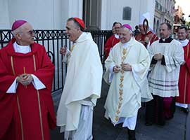 Archbishop Carlo Maria Vigano and Cardinal Daniel N. DiNardo share a light moment before Mass at the USCCB 2014 spring meeting in New Orleans. CNS Photo/Bob Roller