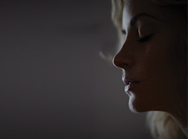A woman in profile represents victims of domestic abuse. October is Domestic Abuse Awareness Month.