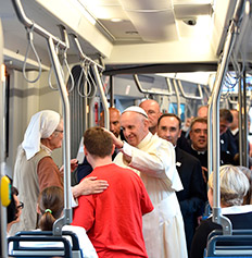 WYD 2016 - Pope Francis greets young man on tram