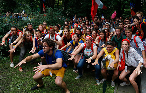 Young people attending World Youth Day perform a spontaneous cheer in Krakow, Poland, July 28. (CNS photo/Paul Haring)