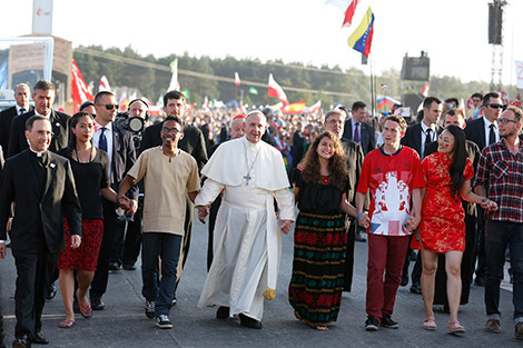 Pope Francis walks with World Youth Day pilgrims as he arrives for a July 30 prayer vigil at the Field of Mercy in Krakow, Poland. (CNS photo/Paul Haring)