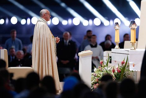 Pope Francis prays during the benediction at a July 30 World Youth Day prayer vigil at the Field of Mercy in Krakow, Poland. (CNS photo/Paul Haring)