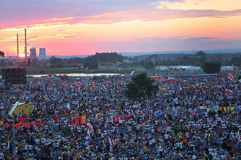 The sun sets over World Youth Day pilgrims as Pope Francis attends a July 30 prayer vigil at the Field of Mercy in Krakow, Poland. (CNS photo/Bob Roller)