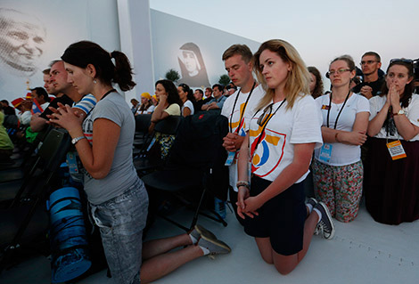 World Youth Day pilgrims kneel in prayer July 30 as Pope Francis leads the benediction during a prayer vigil at the Field of Mercy in Krakow, Poland. (CNS photo/Paul Haring)