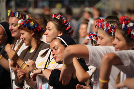World Youth Day pilgrims sing and dance following a July 30 prayer vigil at the Field of Mercy in Krakow, Poland. (CNS photo/Bob Roller)