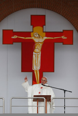 Pope Francis points to a crucifix outside shrine as he greets crowd in Brazil. (CNS photo/Paul Haring)