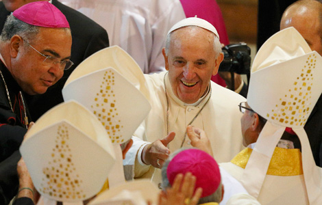 Pope Francis greets bishops as he arrives to celebrate Mass in the Cathedral of St. Sebastian. (CNS photo/Paul Haring)