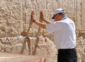 Bishop Madden offers prayers in 2010 at the Western Wall.