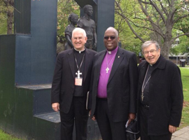 Archbishop Kurtz with Bishop Madden and Methodist Bishop Warner Brown stand in Kelly Ingram Park