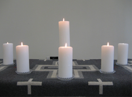 Five candles represent the five faith families in CCT- a Christ candle is in the center