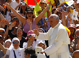 Pope Francis waves to the crowds gathered for one of his weekly audiences.