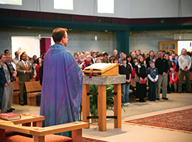 A priest leads a congregation at Mass. USCCB photo by Maria Pope.