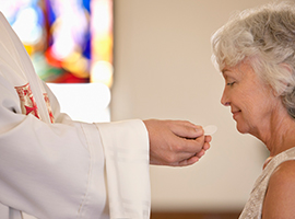 A woman receives the Eucharist.