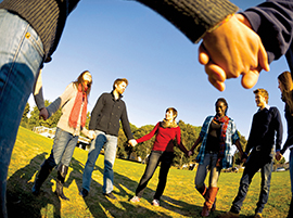 A circle of young people holding hands in prayer. iStock photo for illustrative purposes only.