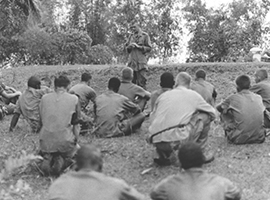 Marine chaplain Father Vincent R. Capodanno celebrates Mass for the troops in the field in Vietnam.  U.S. Government photo.