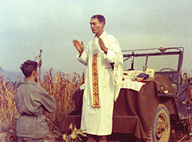 Father Emil Kapuan who served as a U.S. Army chaplain during the Korean War celebrates Mass in the field. Kapuan later died in a Korean P.O.W. camp and was awarded the Medal of Honor for his bravery there. U.S. Government photo.