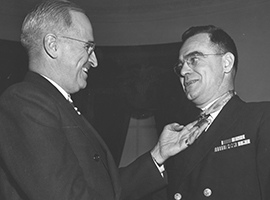 Chaplain and Catholic priest Joseph T. OCallahan receives the Congressional Medal of Honor from President Harry S. Truman. U.S. Government photo.
