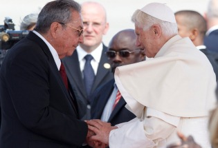 Pope Benedict XVI is greeted by Cuban President Raul Castro during a visit in 2013. CNS Photo/Paul Haring