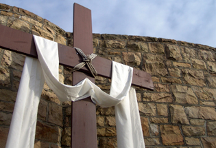 A white draped cross symbolizes the resurrection. iStock image.