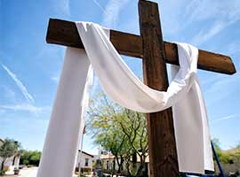 A cross draped with a white sash for Easter is seen on the campus of St. Peter Indian Mission School in Bapchule, Arizona. CNS Photo/Nancy Wiechec