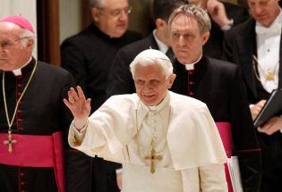 Pope Benedict XVI greets pilgrims at an audience in December 2011.  CNS Photo/Paul Haring
