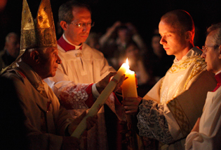 Pope Benedict XVI lights a candle at the 2011 Easter Virgil at the Vatican. CNS Photo/Paul Haring