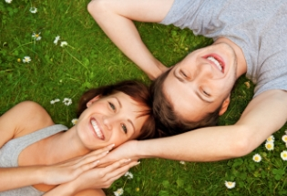 smiling young couple grass iStock home