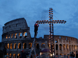 worker-lights-torches-on-cross-ahead-of-2012-way-of-the-cross-in-rome-cns-paul-haring-montage-0009.jpg