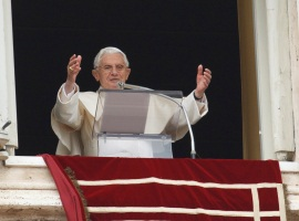 Pope Benedict XVI prays the Angelus from one his apartment windows in the Vatican. CNS Photo/Paul Haring
