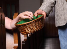 A collection basket is passed during a service. -iStock photo used for illustrative purposes only.