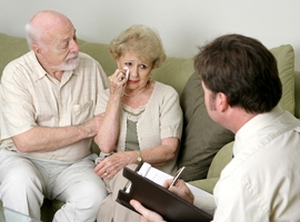 A grieving couple meets with a counselor. iStock photo.