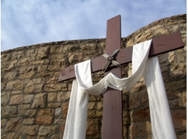 A cross draped in white is symbolic of the Easter season. iStock image.