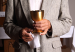 Layman holds chalice.